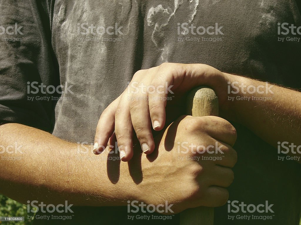 Hands resting on a wooden handle royalty-free stock photo