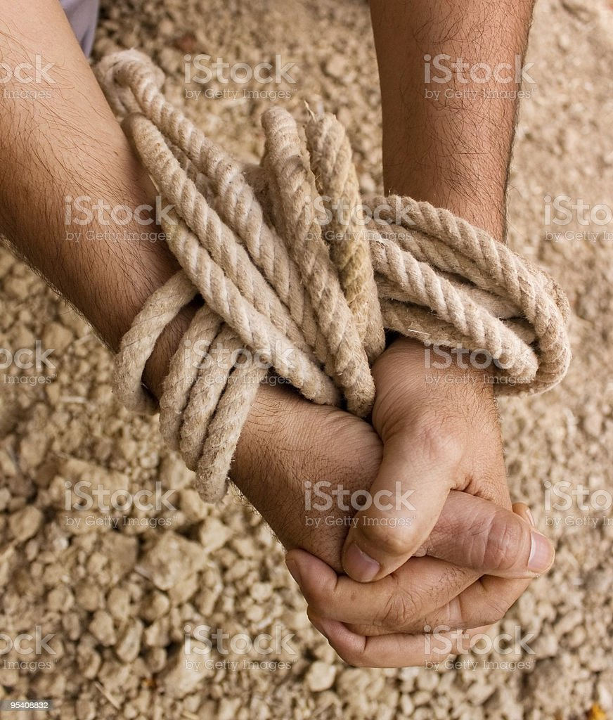 Hands & Rope stock photo