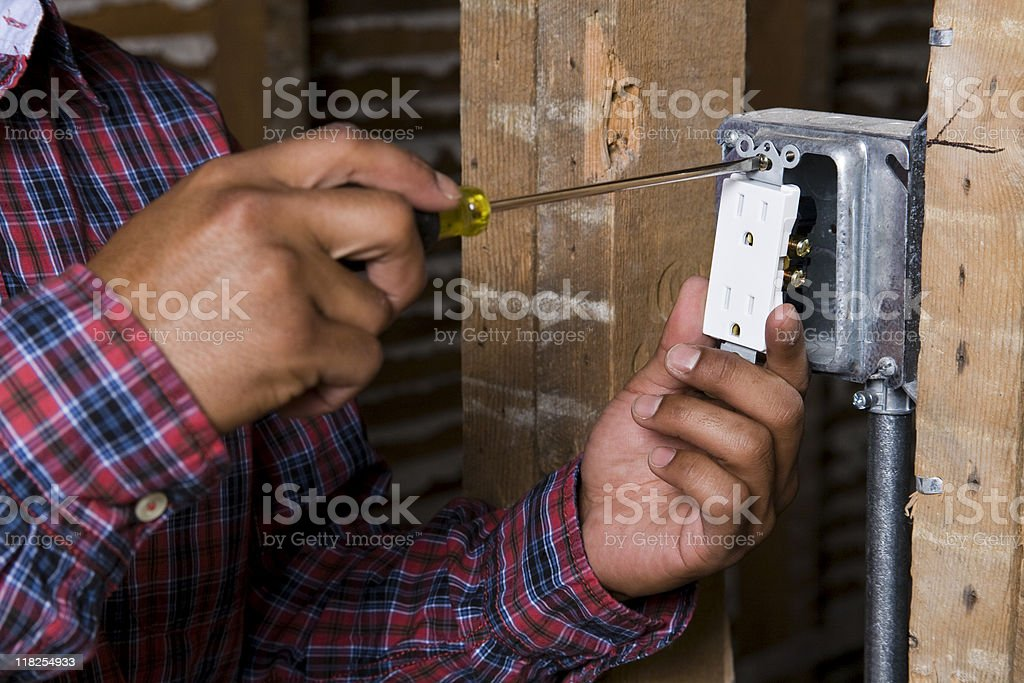 Hands screwing in an electrical outlet royalty-free stock photo