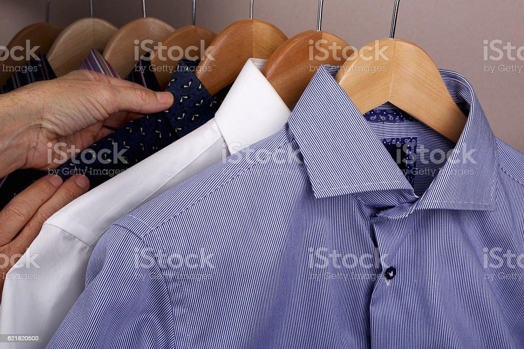 Hands selecting shirt. stock photo