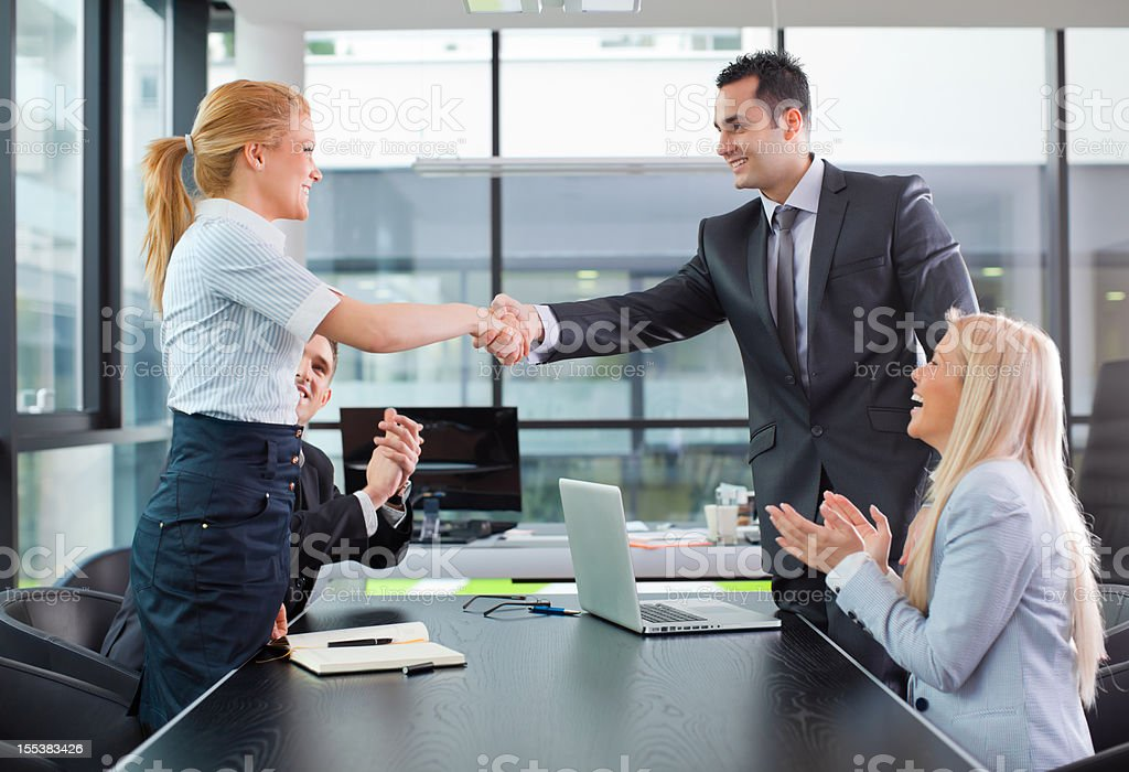 Hands shaking royalty-free stock photo