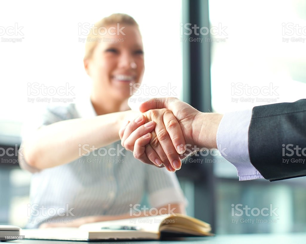 Hands shaking stock photo