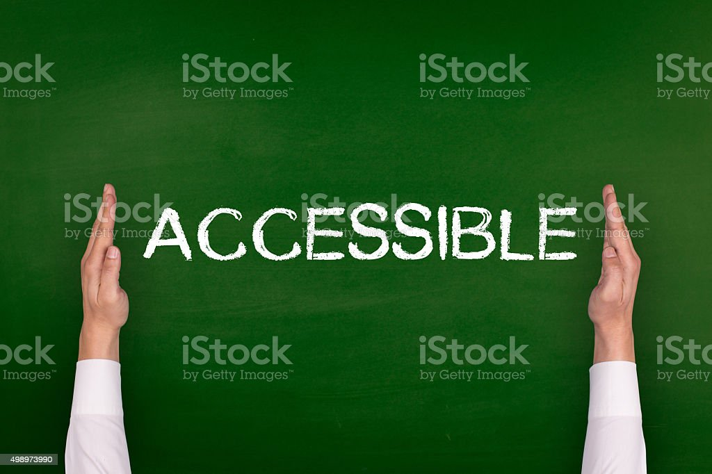 Hands Showing ACCESSIBLE on Blackboard stock photo