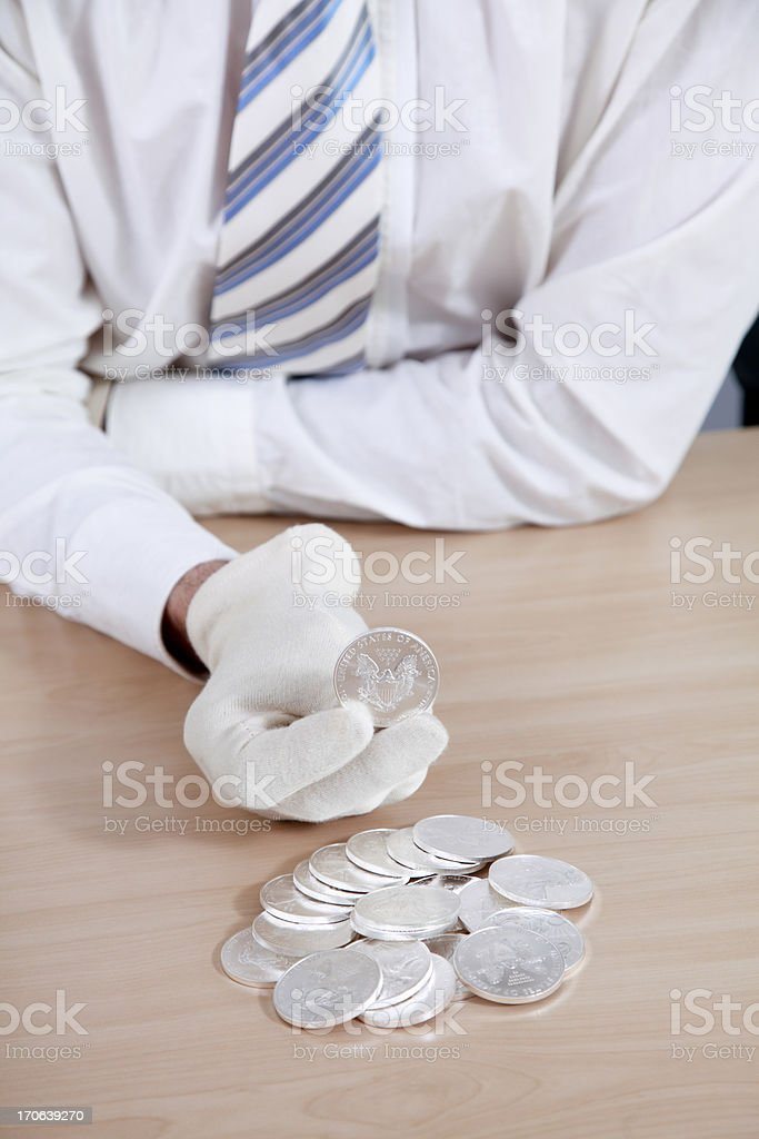 Hands showing sillver US coins royalty-free stock photo