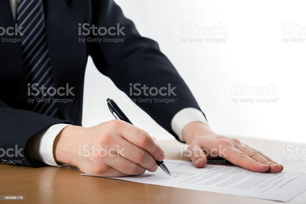 Hands signing business documents. Signing papers. Lawyer, realto stock photo