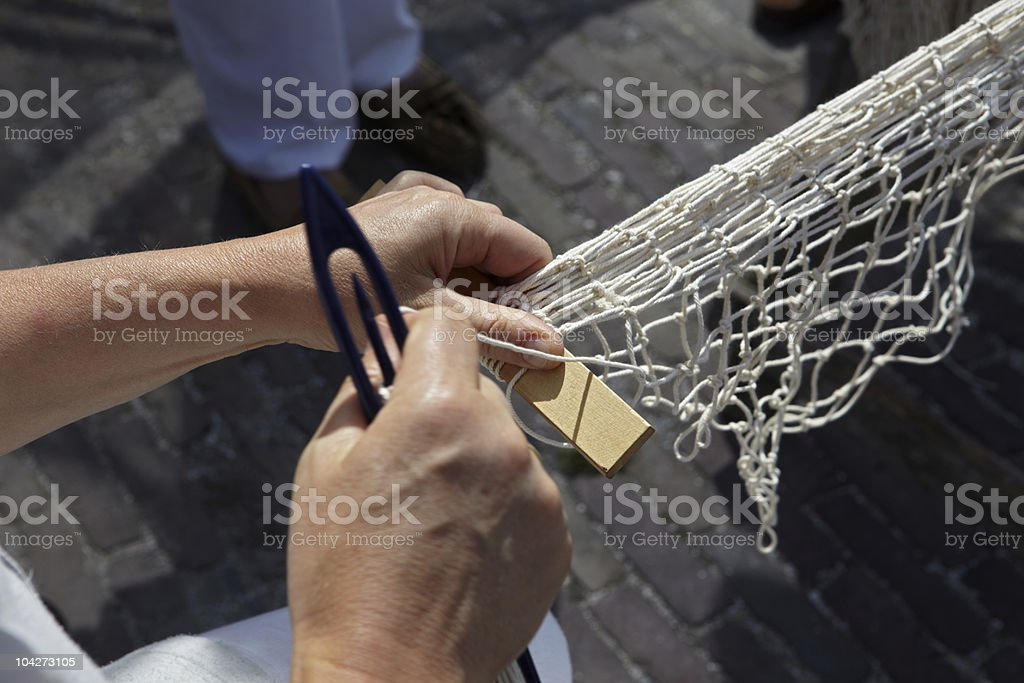 Hands spin a fishing net stock photo