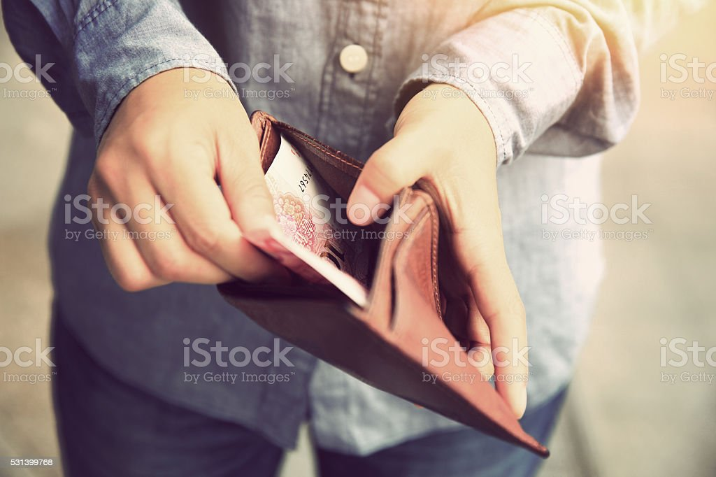 Hands taking  money  out from wallet on the street stock photo