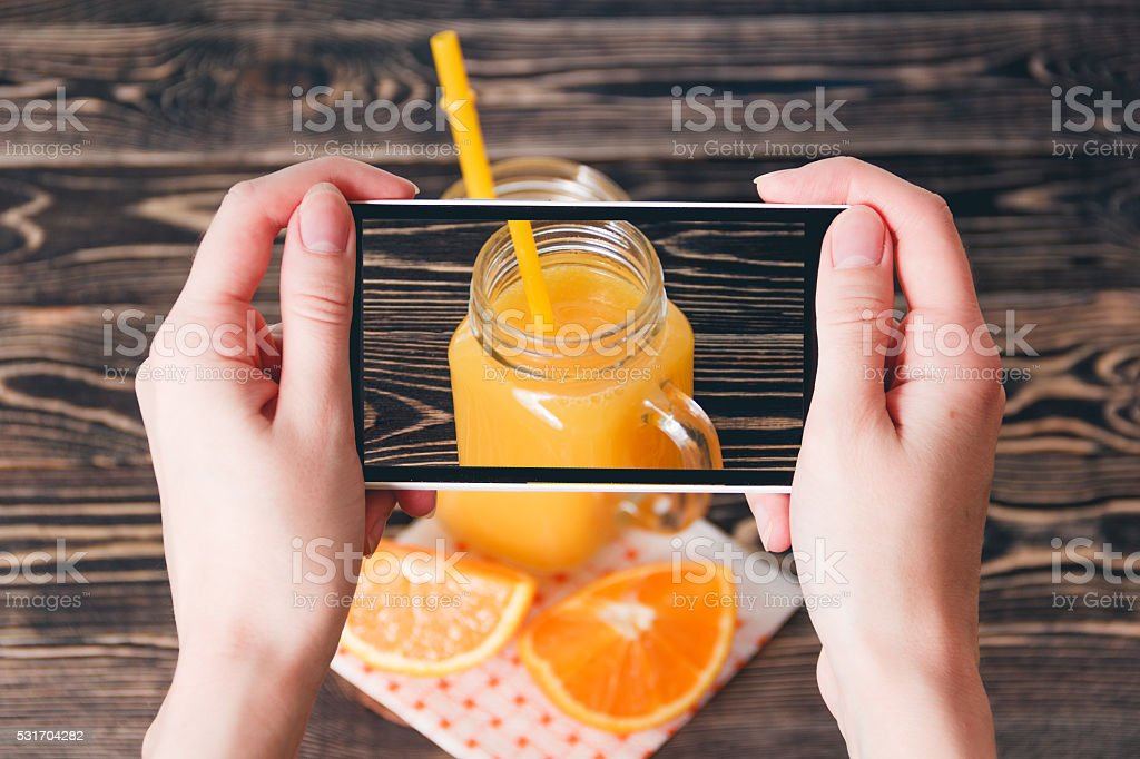 Hands Taking Photo of Oranges. Technology Concept stock photo