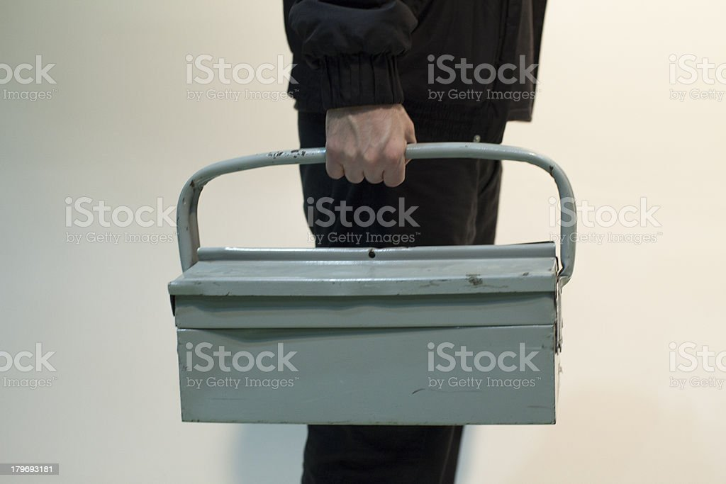 Hands taking Tool Case royalty-free stock photo