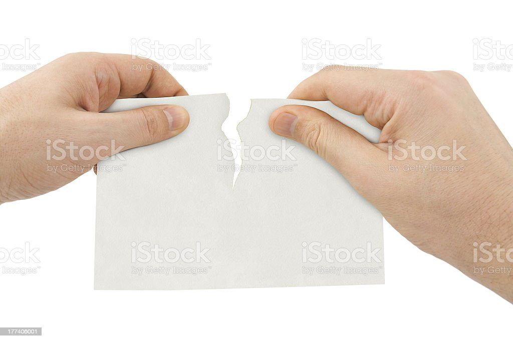Hands tear paper stock photo