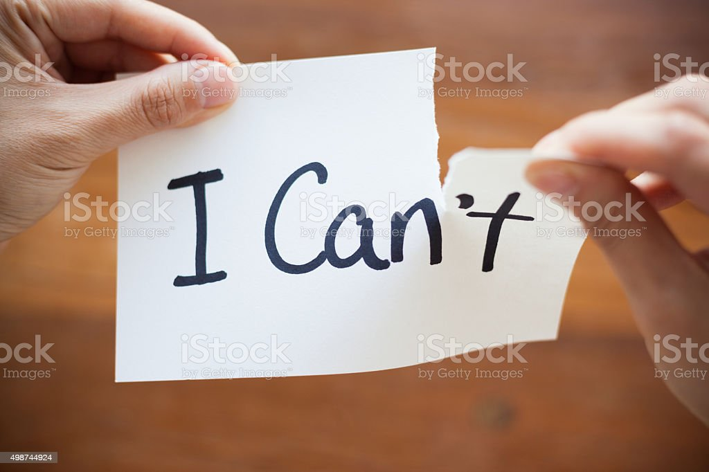Hands Tearing Paper with Words - I Can't become Can stock photo