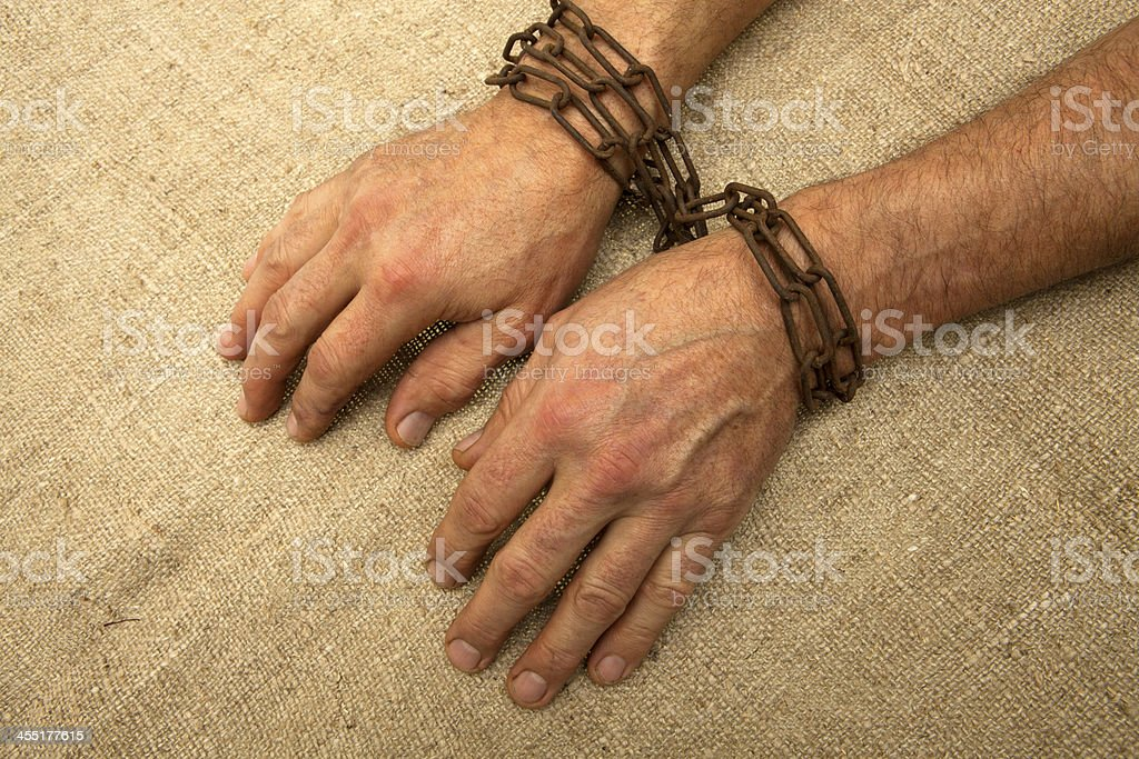 Hands tethered chain royalty-free stock photo