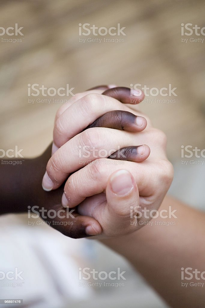 hands that are interwoven stock photo