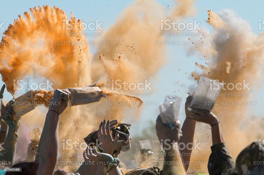 Hands Throw Packets Of Colored Corn Starch At Color Run stock photo