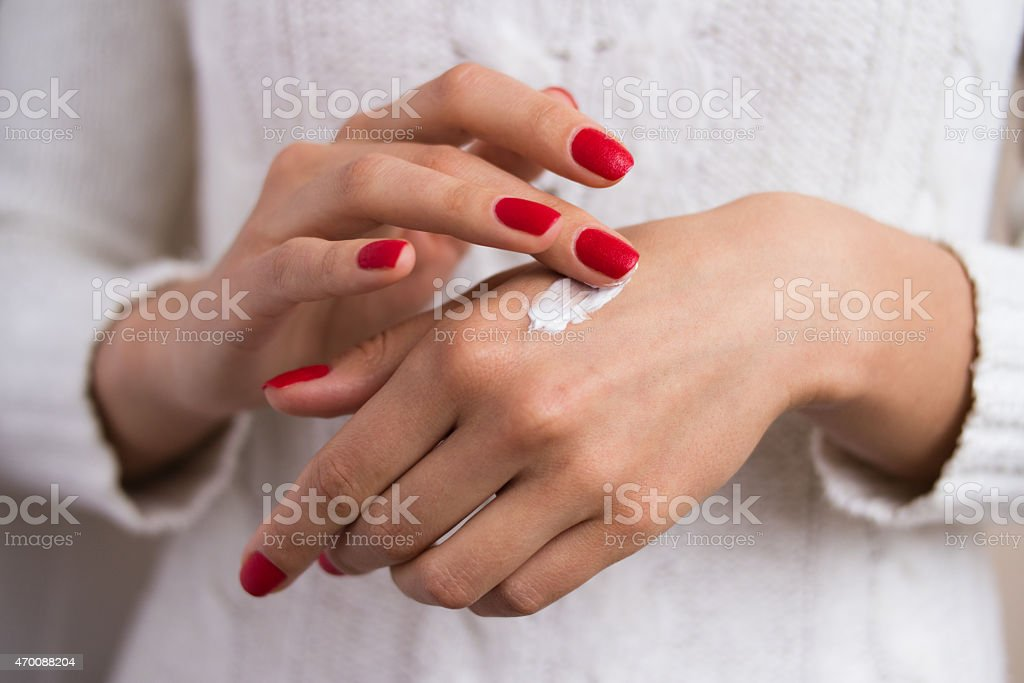 Hands to apply the cream stock photo