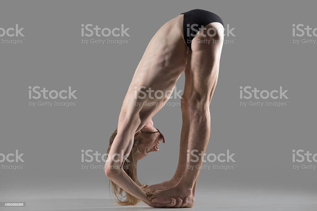 Hands to Feet Pose (Padahastasana) yoga posture stock photo