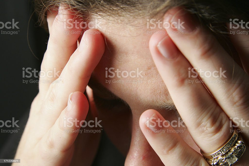 Hands to head with headache stock photo