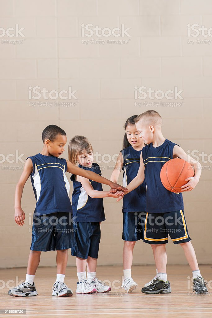 Hands Together in a Huddle stock photo
