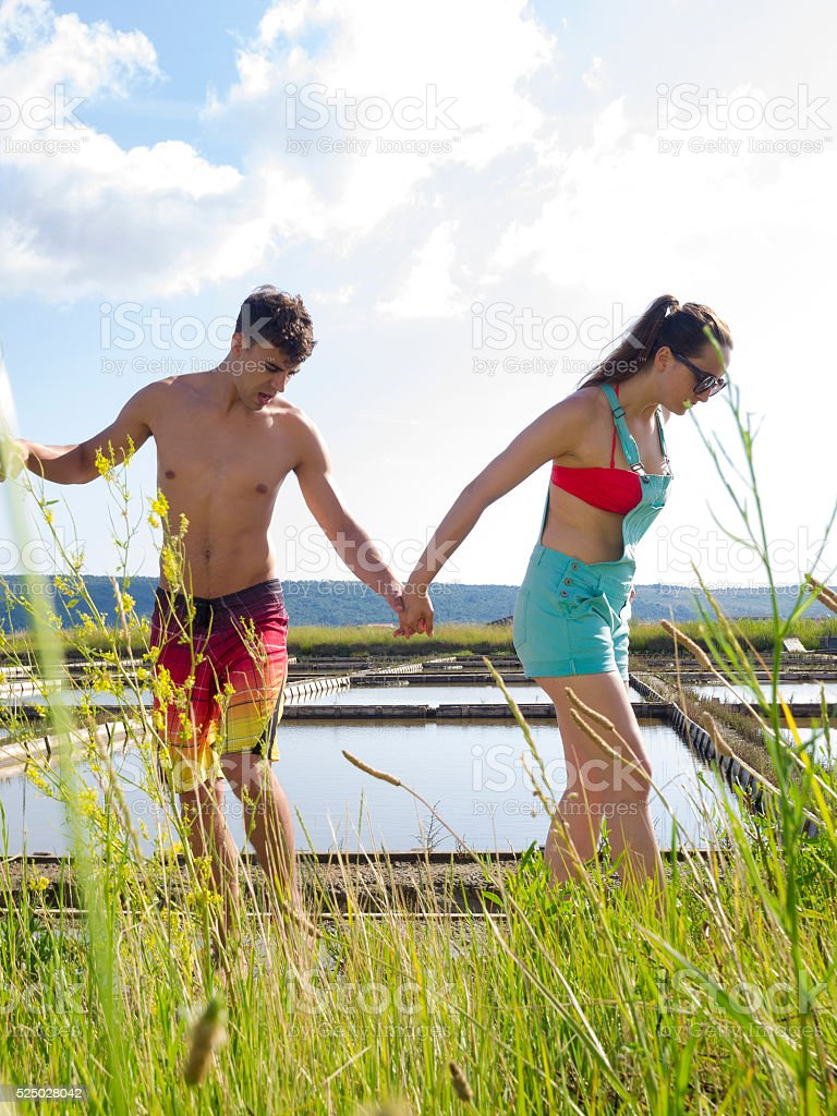 Hands together in nature stock photo