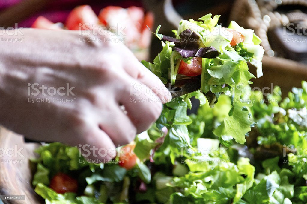 Hands tossing a salad royalty-free stock photo