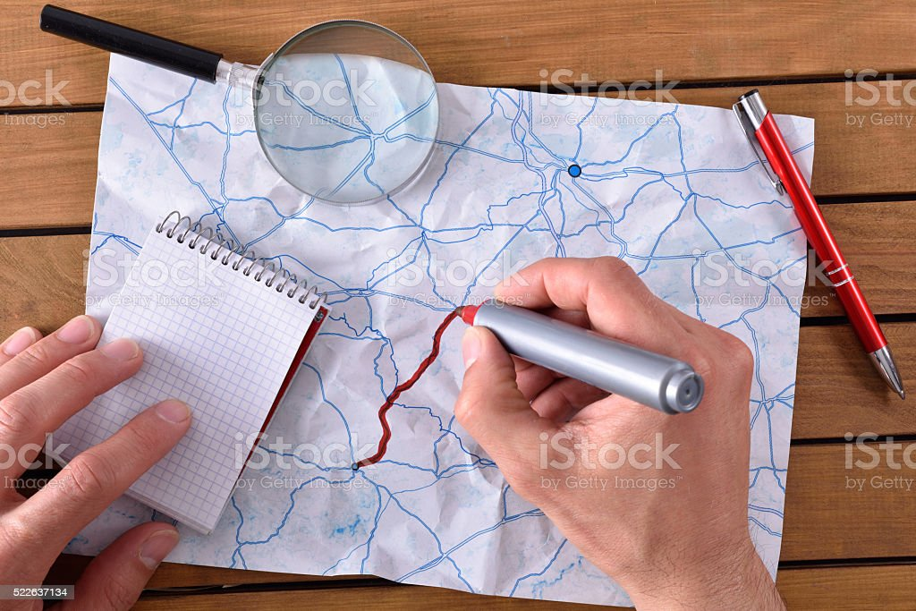 Hands tracing a path on a map stock photo