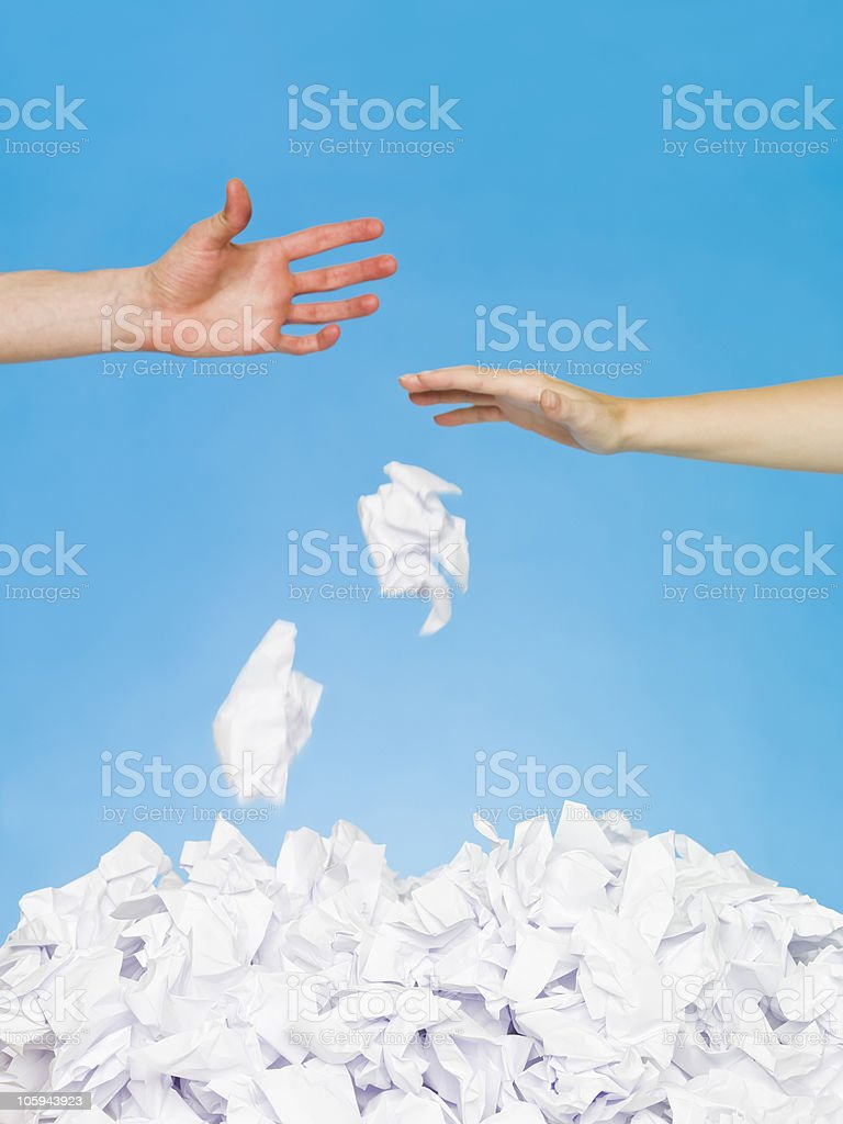 Hands trowing papers royalty-free stock photo