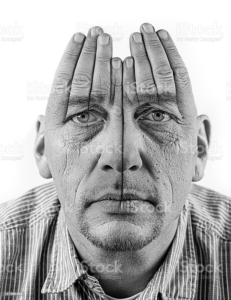 Hands trying to cover eyes royalty-free stock photo