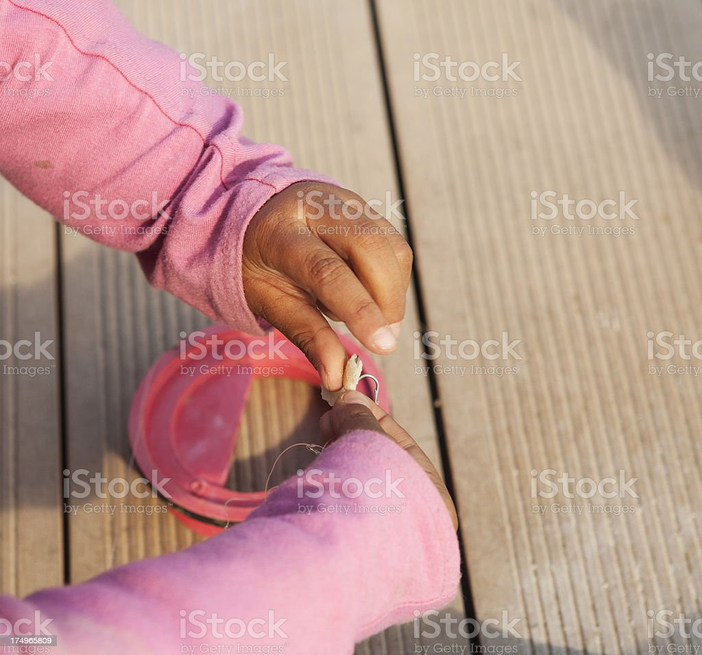 Hands Tying a Fishing Lure stock photo