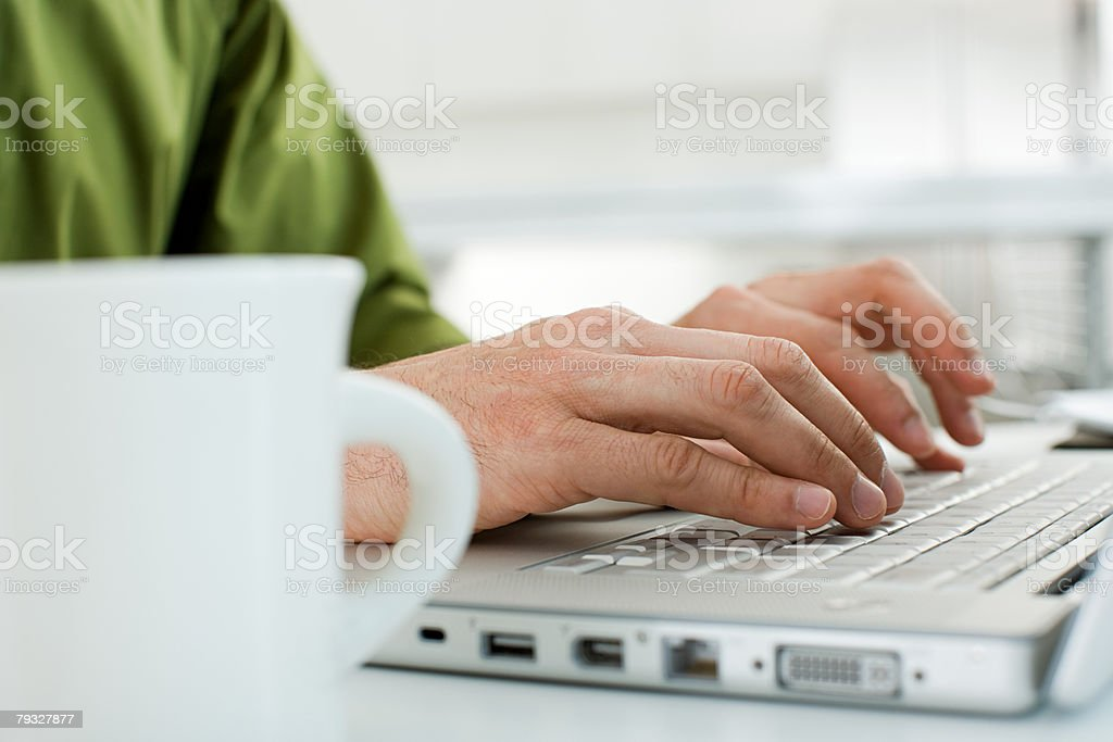 Hands typing on a laptop computer royalty-free stock photo