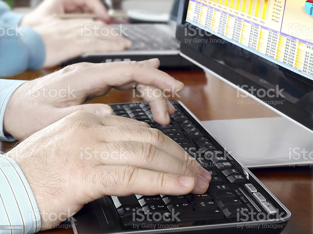 Hands typing on computer keyboard royalty-free stock photo