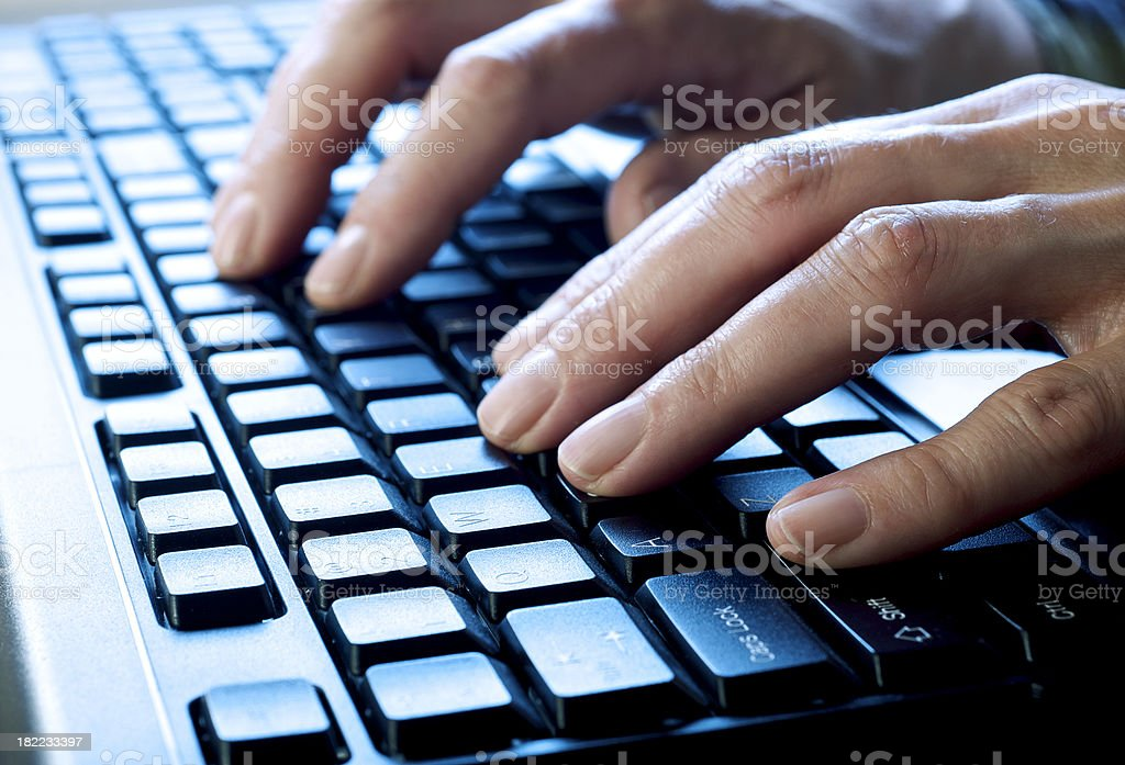 Hands Typing On Computer Keyboard stock photo