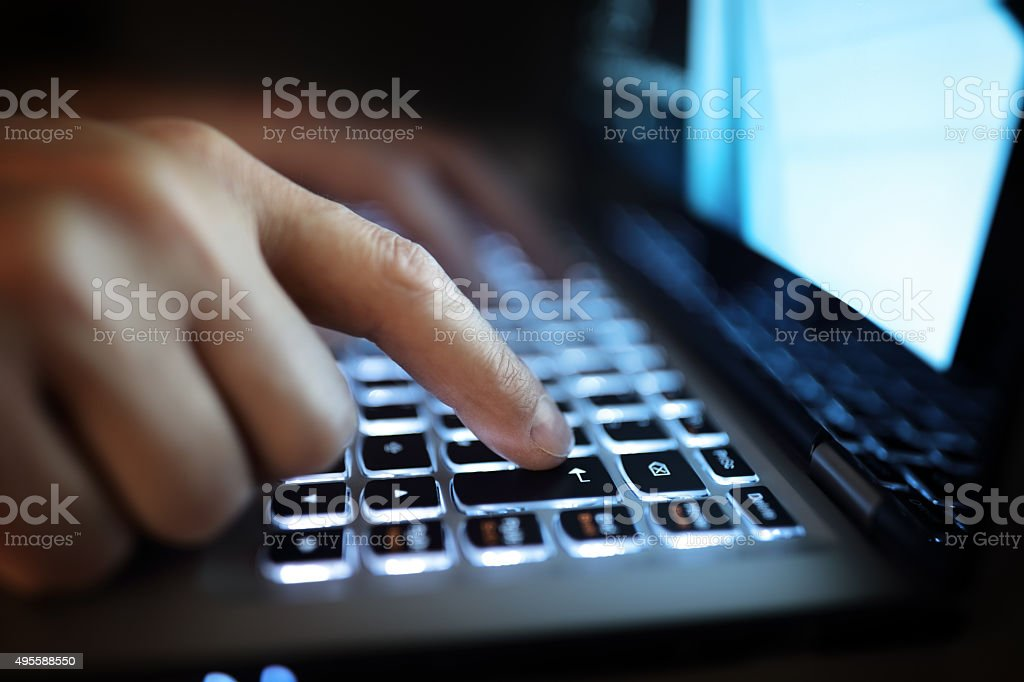 Hands typing on laptop computer stock photo