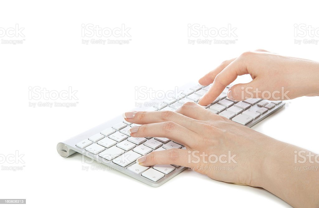 Hands typing on the remote wireless computer keyboard royalty-free stock photo
