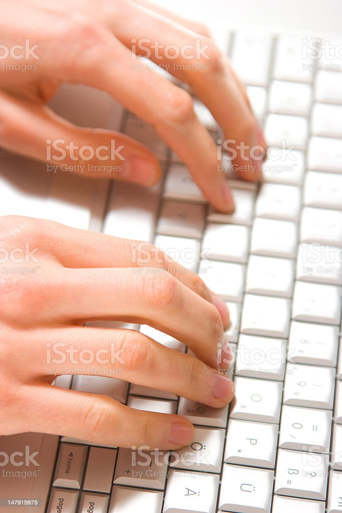 hands typing on white keyboard royalty-free stock photo