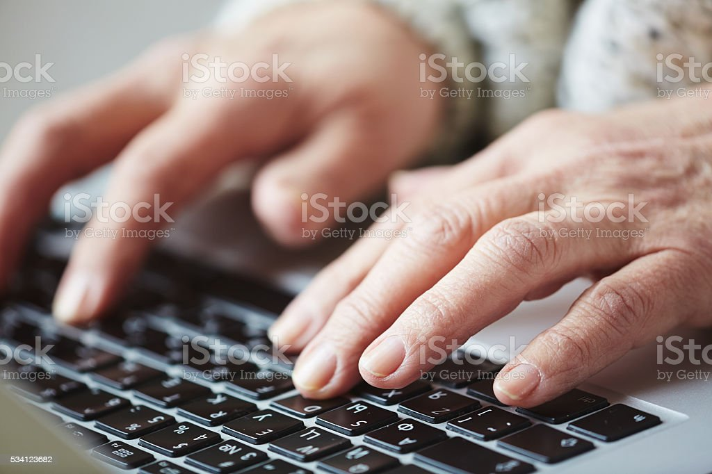 Hands typing stock photo