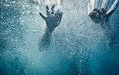 Hands underwater