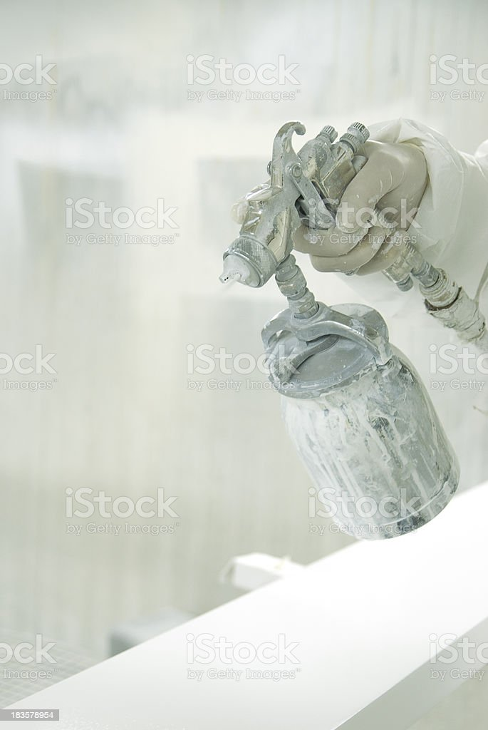 Hands using air brush royalty-free stock photo