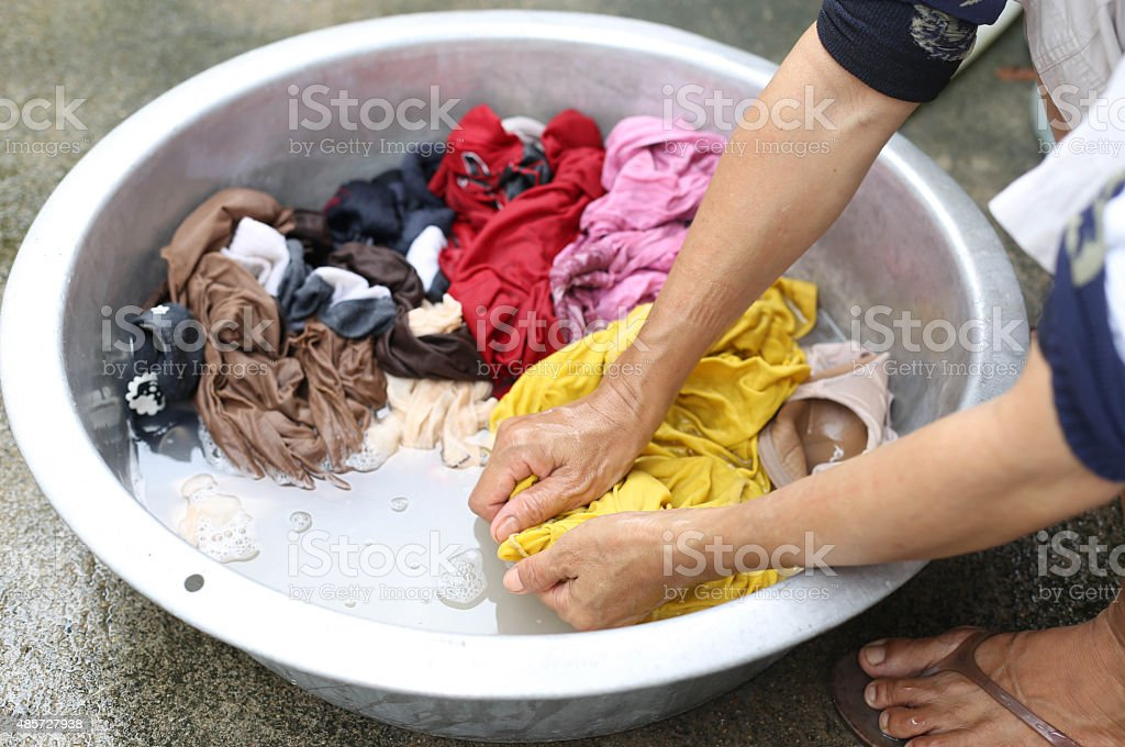 Hands wash stain of dirty clothes stock photo