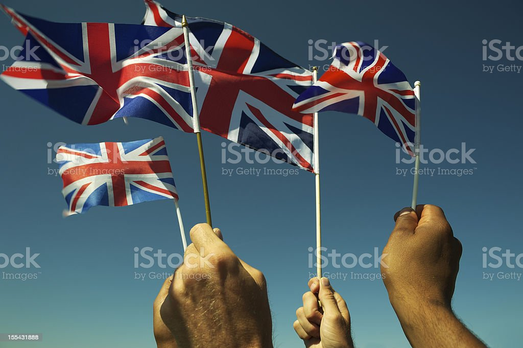 Hands Wave Union Jack British Flags Blue Sky stock photo