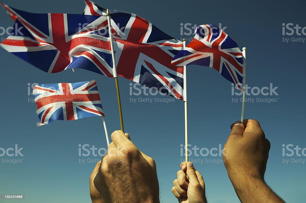 Hands Wave Union Jack British Flags Blue Sky stock photo