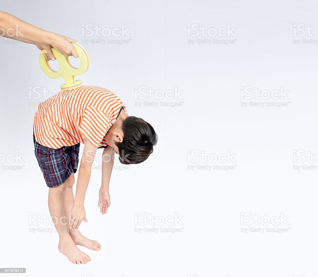 Hands wind energry boost to boy  start like wind up stock photo