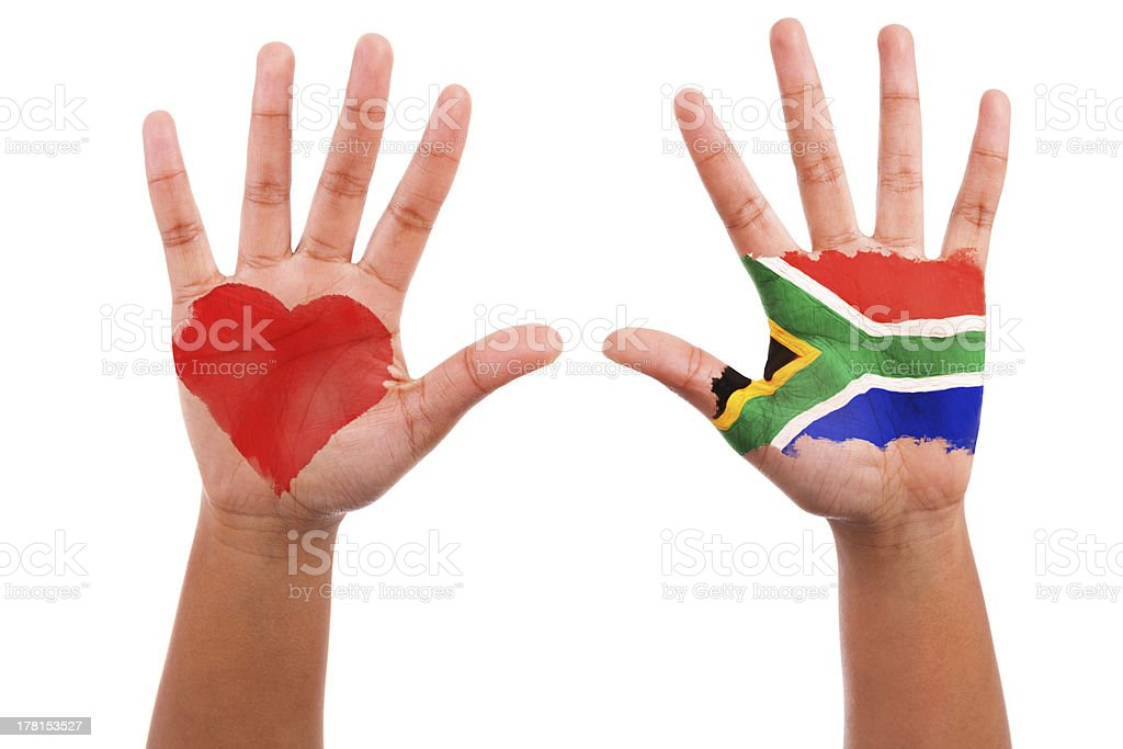 Hands with a painted heart and south african flag royalty-free stock photo