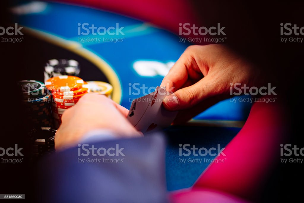Hands with a pair of aces stock photo