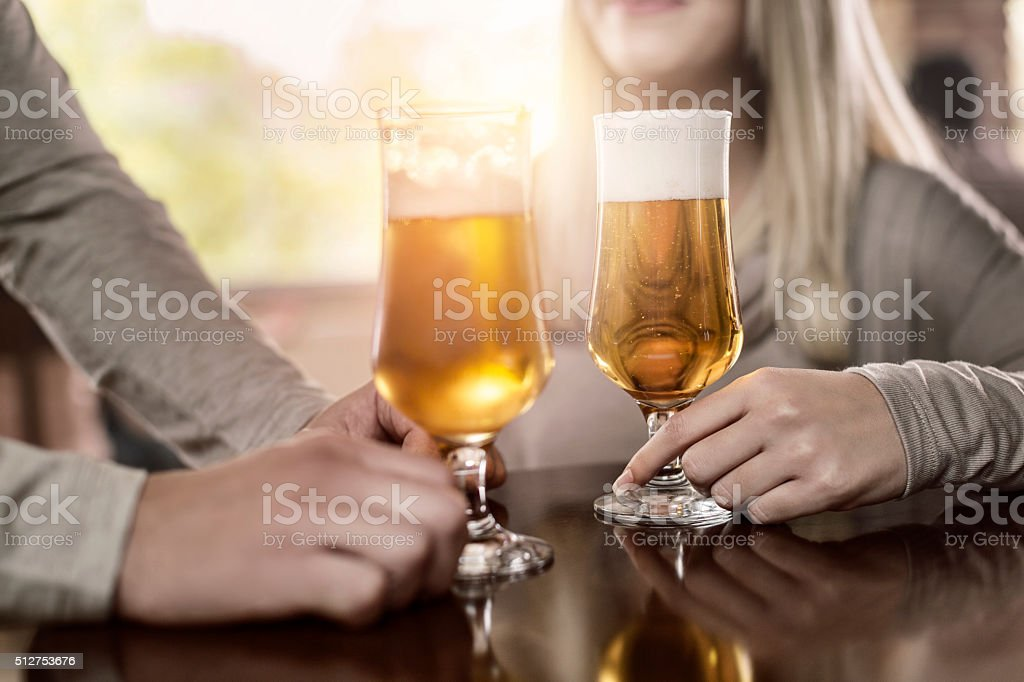 Hands with beer stock photo