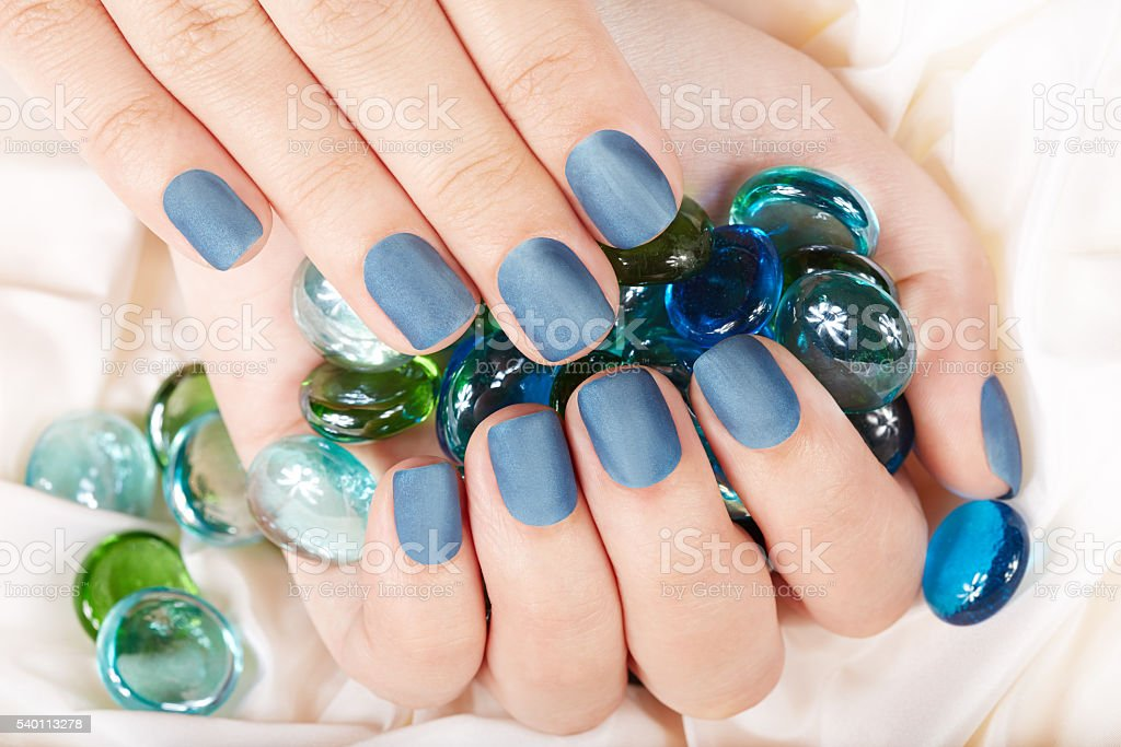 Nails with blue matte manicure