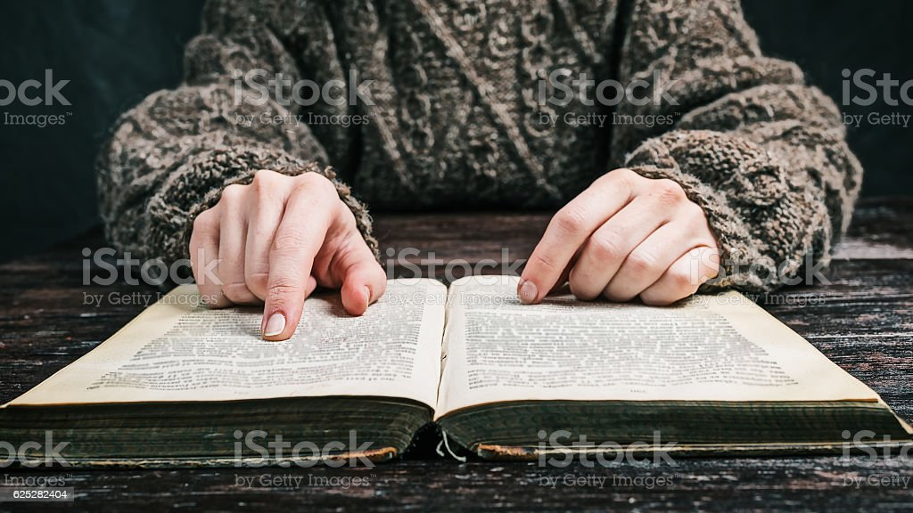 Hands with book stock photo