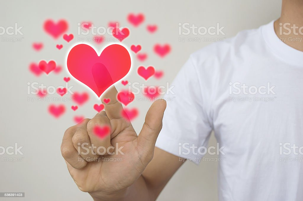 Hands with buttom  hearts. Man touch for Valentine's day. stock photo