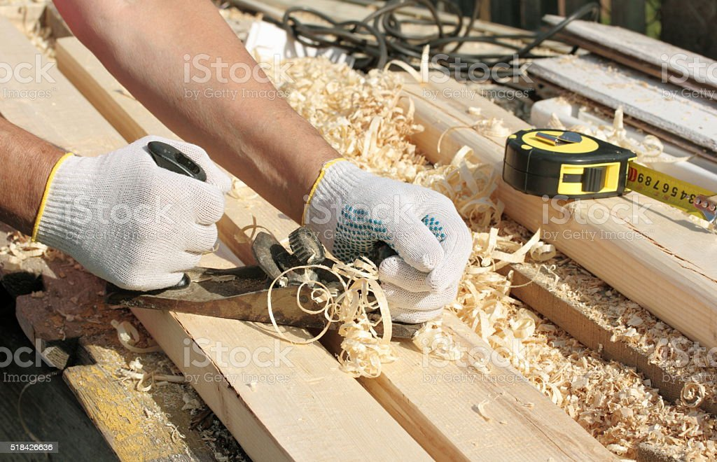 hands with carpenters plane stock photo