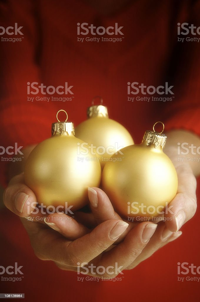 Hands with Christmas ornaments royalty-free stock photo