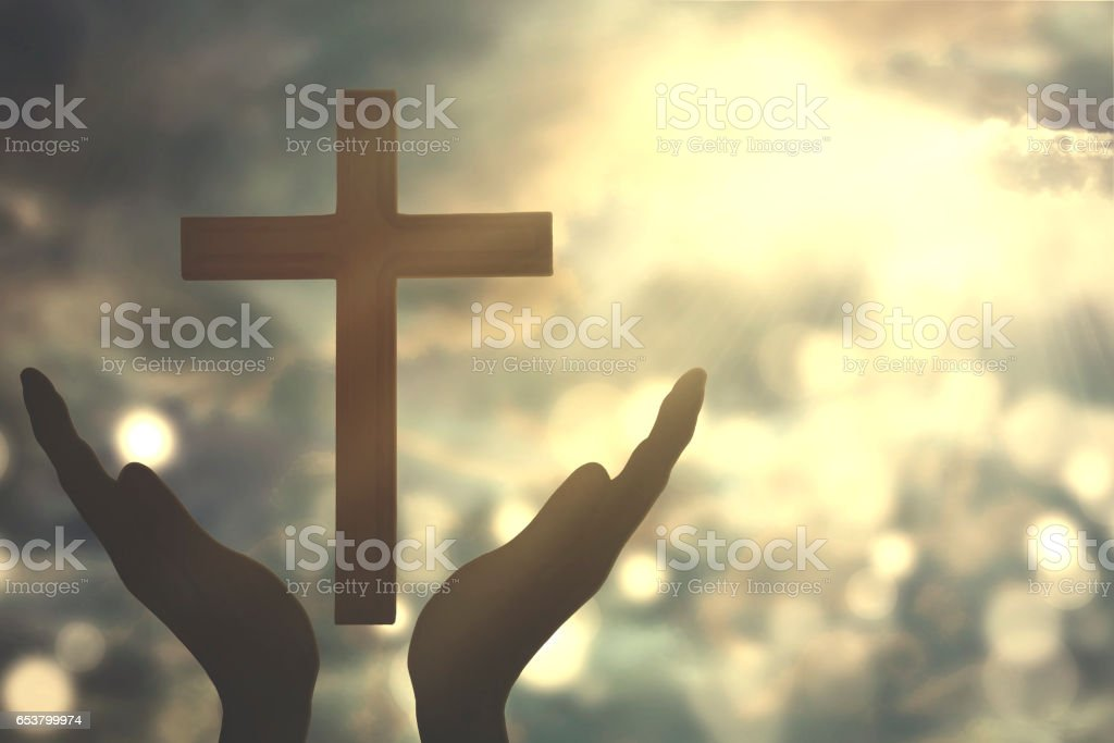 Hands with cross worshiping to the GOD stock photo